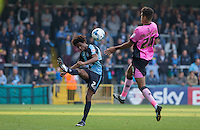 Sido Jombati of Wycombe Wanderers hits the ball upfield under pressure from Dominic Calvert-Lewin of Northampton Town during the Sky Bet League 2 match between Wycombe Wanderers and Northampton Town at Adams Park, High Wycombe, England on 3 October 2015. Photo by Andy Rowland.