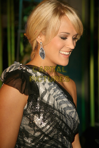 Carrie Underwood.59th Annual BMI Country Awards held at BMI Music Row Headquarters, Nashville, Tennessee, USA..November 8th, 2011.headshot portrait black silver sheer one shoulder earrings profile .CAP/ADM/BEV.©Bev MoserAdMedia/Capital Pictures.