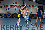 Kieran Donaghy Tralee Warriors powers past Darragh Jones Keanes Supervalu Killorglin during the Premier Mens final at St Marys Christmas Bastketball blitz on Monday night