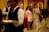 .Guests attending a wedding in the City of El Alto..Just 25 years ago it was a small group of houses around La Paz  airport, at an altitude of 12,000 feet. Now El Alto city  has  nearly one million people, surpassing even the capital of Bolivia, and it is the city of Latin America that grew faster ...It is also a paradigmatic city of the tubles and traumas of the country. There got refugee thousands of miners that lost  their jobs in 90 ¥s after the privatization and closure of many mines. The peasants expelled by the lack of land or low prices for their production. Also many who did not want to live in regions where coca  growers and the Army  faced with violence...In short, anyone who did not have anything at all and was looking for a place to survive ended up in El Alto...Today is an amazing city. Not only for its size. Also by showing how its inhabitants,the poorest of the poor in one of the poorest countries in Latin America, managed to get into society, to get some economic development, to replace their firs  cardboard houses with  new ones made with bricks ,  to trace its streets,  to raise their clubs, churches and schools for their children.