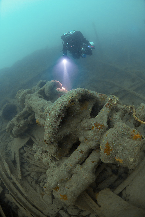 Divers explore the wreck of the SS Syracusa, Newquay, Cornwall, UK