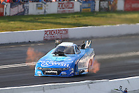 Jun 11, 2016; Englishtown, NJ, USA; NHRA funny car driver Tommy Johnson Jr during qualifying for the Summernationals at Old Bridge Township Raceway Park. Mandatory Credit: Mark J. Rebilas-USA TODAY Sports