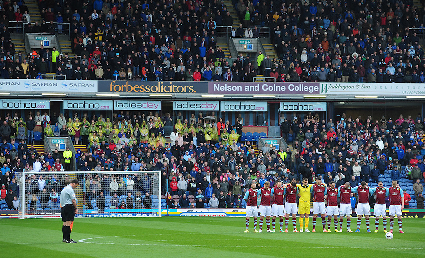 The match officials and Burnley players observe a minutes silence on the 25th anniversary of the Hillsborough disaster<br /> <br /> Photo by Chris Vaughan/CameraSport<br /> <br /> Football - The Football League Sky Bet Championship - Burnley v Middlesbrough - Saturday 12th April 2014 - Turf Moor - Burnley<br /> <br /> &copy; CameraSport - 43 Linden Ave. Countesthorpe. Leicester. England. LE8 5PG - Tel: +44 (0) 116 277 4147 - admin@camerasport.com - www.camerasport.com