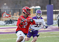 UAlbany Men's Lacrosse defeats Stony Brook on March 31 at Casey Stadium.  Wayne White (#12) defended by Erik Dluhy (#37).