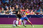 Luciano Vietto (r) of Atletico de Madrid fights for the ball with Clement Nicolas Laurent Lenglet of Sevilla FC during the La Liga 2017-18 match between Atletico de Madrid and Sevilla FC at the Wanda Metropolitano on 23 September 2017 in Wanda Metropolitano, Madrid, Spain. Photo by Diego Gonzalez / Power Sport Images