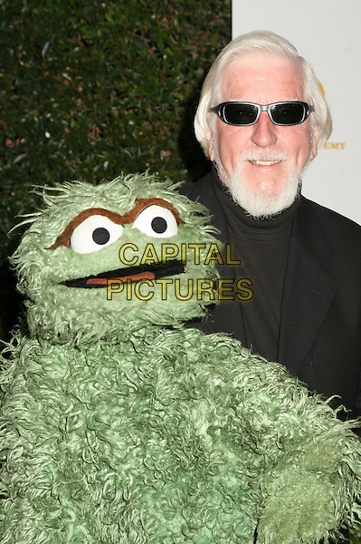 "OSCAR THE GROUGH & CAROLL SPINNEY.""Daytime Emmy Nominee Party"" Presented by SoapNet held at The Hollywood Roosevelt Hotel, Holywood, California, USA..April 27th, 2006.Photo: Byron Purvis/AdMedia/Capital Pictures.Ref: BP/ADM.headshot portrait sunglasses shades.www.capitalpictures.com.sales@capitalpictures.com.© Capital Pictures."