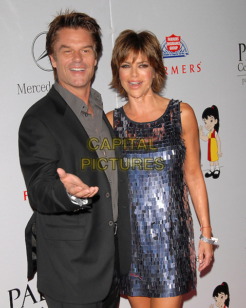 HARRY HAMLIN & LISA RINNA.The 7th Annual El Sueno de Esperanza Benefit Gala to raise funds for Padres Contra El Cancer held at The Lot in West Hollywood, California, USA..October 18th, 2007.headshot portrait hand black suit jacket metallic dress blue silver married husband wife .CAP/DVS.©Debbie VanStory/Capital Pictures