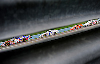 Aug. 8, 2009; Watkins Glen, NY, USA; NASCAR Nationwide Series driver Kyle Busch (18) leads a pack of cars during the Zippo 200 at Watkins Glen International. Mandatory Credit: Mark J. Rebilas-