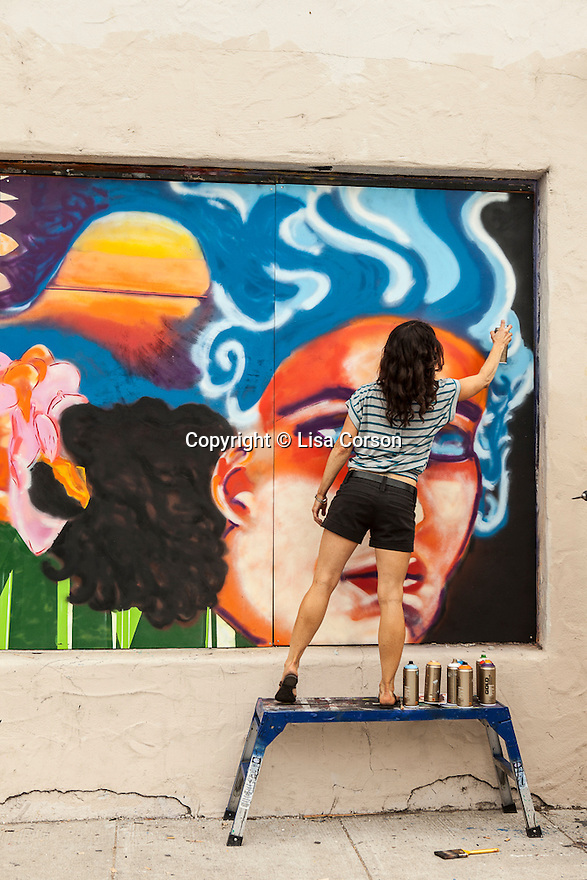 Artist Chandra Carr paints a mural on Mason Street in Santa Barbara's Funk Zone. Santa Barbara, CA. Images are available for editorial licensing, either directly or through Gallery Stock. Some images are available for commercial licensing. Please contact lisa@lisacorsonphotography.com for more information.
