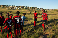 NDEVANA, SOUTH AFRICA MAY 5: Linamandla Deliwe gives out soccer uniforms to a local team on May 5, 2018 in Ndevana, South Africa. Lina was born and lives in Cape Town but he grew up in Ndevana. He is a successful young man and the tries to uplift the community where his grandmother and many friends still live. Lina has given out many soccer kits, and he is soon opening a library, and he also wants to open a computer lab. The unemployment rate is huge  (about 80-90%) in this forgotten rural area about 50 km from east London, South Africa. (Photo by: Per-Anders Pettersson/Getty Images)