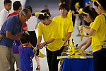 "Visitors receive Pikachu souveniers at the ""1000 Pikachu Outbreak! at Yokohama Minatomirai"" on August 09, 2014. 1000 Pikachu performed at different areas of Minatomirai in Yokohama during the summer vacation event from August 9 to 17.  (Photo by Rodrigo Reyes Marin/AFLO)"