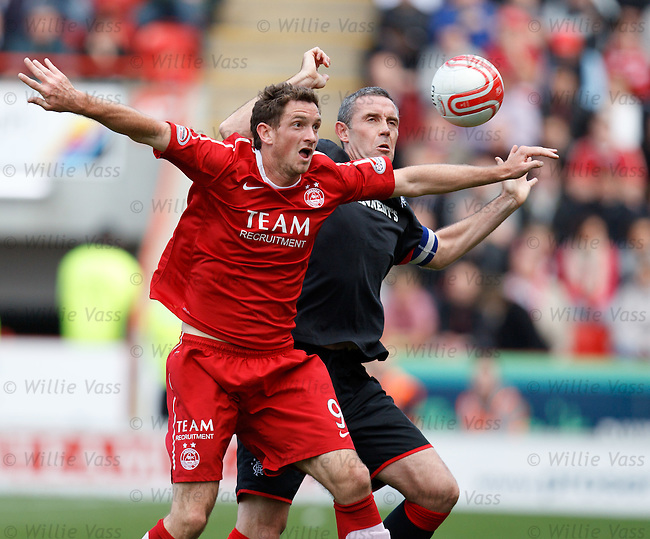 David Weir and Rory McArdle challenge for the ball