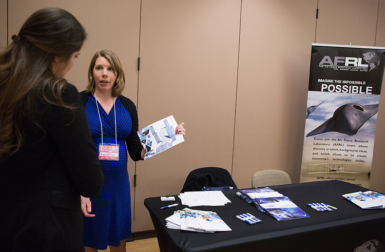 Andrea Helbach, a representative with the Air Force Research Lab and an Ohio University '07 alum, talks to Kaylee Greenawalt, a student at Wright State University, about opportunities with the Air Force Research Lab at the Institute of Industrial and Systems Engineering Regional Conference in Baker Center on Feb. 25, 2017.