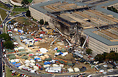 Federal Bureau of Investigation (FBI) agents, fire fighters, rescue workers and engineers work at the Pentagon crash site on Friday, September 14, 2001, where a hi-jacked American Airlines flight slammed into the building on September 11, 2001.  The terrorist attack caused extensive damage to the west face of the building and followed similar attacks on the twin towers of the World Trade Center in New York City.  .Credit: Department of Defense via CNP
