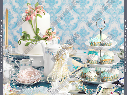 Luxurious tea party still life combining desserts and jewellery