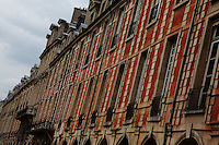 The typical ancient buildings with their mansards, their red bricks and their arcades, in place des Vosges (XVII century) in Paris. This is the north side of the place, with the Pavillon de la Reine (the Pavillon of the Queen). Digitally Improved Photo.