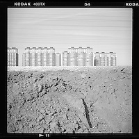 New subsidized homes are built on barren lands on the outskirts of Beijing to relocate city dwellers as part of plans to redevelop the Chinese capital, February, 2014. (Mamiya 6, 75mm, Kodak TRI-X film)