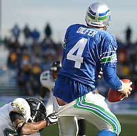 A Jacksonville Jaguars players grabs the back of the pants of Seattle Seahawks quarterback Trent Dilfer accidentally exposing Dilfer's assets at Husky Stadium in Seattle.
