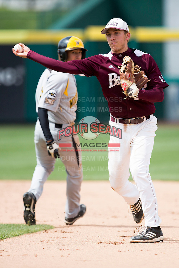 Eric Cheray #14 of the Missouri State Bears throws to first after tagging a base runner during a game against the Wichita State Shockers at Hammons Field on May 5, 2013 in Springfield, Missouri. (David Welker/Four Seam Images)