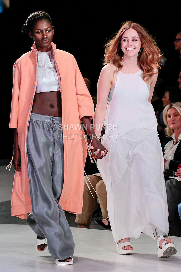 Graduating fashion student Kindall Almond walks runway with model at the close of the 2013 Pratt Institute Fashion Show, on April 25, 2013.