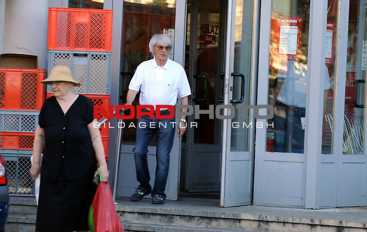 03.08.2013., Croatia, Sibenik - EXCLUSIVE PHOTOS - The owner of Formula 1 Bernie Ecclestone is on vacation on the Croatian coast. The morning he  spent walking with friends. Without bodyguards  Bernie was talking with citizens and went shopping in the town market.<br /> <br /> Foto &not;&copy;  nph   / Hrvoje JelavicL