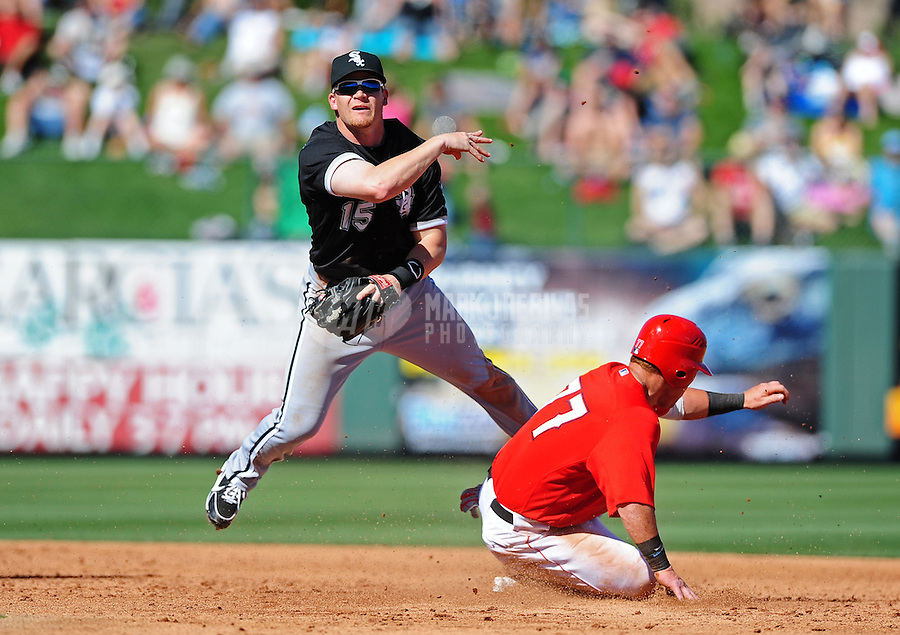 Mar. 6, 2012; Tempe, AZ, USA; Chicago White Sox second baseman Gordon Beckham throws to first to complete the double play after forcing out Los Angeles Angels base runner (77) Kole Calhoun in the third inning of a spring training game at Tempe Diablo Stadium.  Mandatory Credit: Mark J. Rebilas-