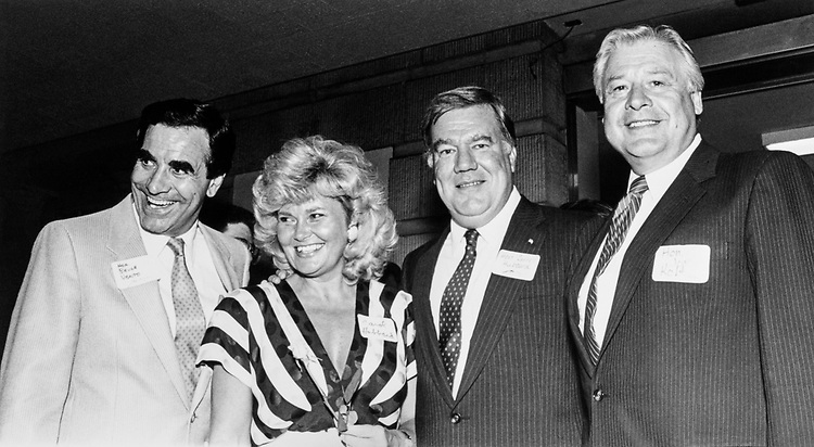 Rep. Carroll Hubbard, D-Ky. pose for photo with wife Carol Hubbard, Rep. Bruce Vento, D-Minn. And Rep. Joseph P. Kolter, D-Pa. on July 24, 1988. (Photo by Andrea Mohin/CQ Roll Call)
