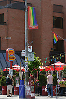 Church Street in The   Village ;  a predominantly gay neighbourhood in the heart of downtown Toronto.........Home to Canada's largest gay community, Toronto welcomes gay and lesbian visitors with a full slate of entertaining things to see and do year-round. While Toronto is home to more than 4 million people, the gay and lesbian village is nestled in the downtown core, centered around the intersection of Church and Wellesley Streets. The area is packed with cafÈs, restaurants, gay-oriented shops and a vast array of bars and hot nightspots.....Photo : Pierre Roussel - Images Distribution