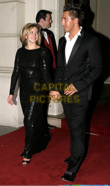 CHARLOTTE CHURCH & GAVIN HENSON.The 8th Anual GQ Men of The Year Awards,.The Royal Opera House,.London, 6th September 2005.full length black suit white shirt sparkly sequin dress couple holding hands.www.capitalpictures.com.sales@capitalpictures.com.© Capital Pictures.