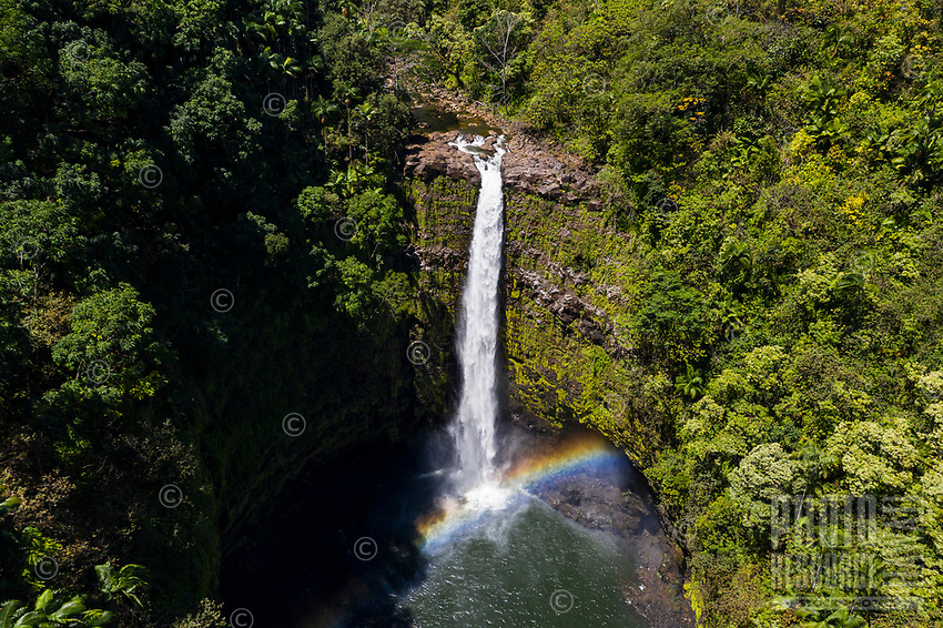 A rainbow bridges the base of 'Akaka Iki Falls, Big Island of Hawai'i.