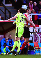 Lincoln City's Matt Rhead vies for possession with York City's Sean Newton<br /> <br /> Photographer Andrew Vaughan/CameraSport<br /> <br /> Buildbase FA Trophy Semi Final Second Leg - Lincoln City v York City - Saturday 18th March 2017 - Sincil Bank - Lincoln<br />  <br /> World Copyright &copy; 2017 CameraSport. All rights reserved. 43 Linden Ave. Countesthorpe. Leicester. England. LE8 5PG - Tel: +44 (0) 116 277 4147 - admin@camerasport.com - www.camerasport.com