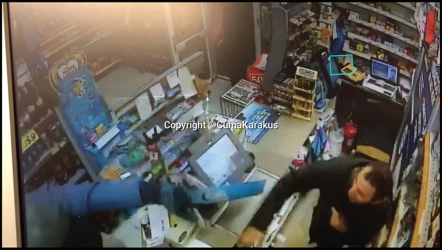BNPS.co.uk (01202 558833)<br /> Pic: CumaKarakus/BNPS<br /> <br /> The moment Cuma throws the jar of dog treats at the robber.<br /> <br /> This is the dramatic movement a heroic shopkeeper scared off a knife-wielding raider by launching a glass jar of dog biscuits at him. <br /> <br /> Brave Cuma Karakus dodged the masked thug's eight inch blade as he jabbed over the counter armed only with the treats he keeps for customers' pets. <br /> <br /> The dad of two then incredibly threw it at the crook as he tried to run around the table, appearing to hit a glancing blow on his hand.