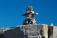 Inukshuk and preCambrian Shield<br />  Yellowknife Highway<br /> Northwest Territories<br /> Canada
