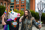 "© Joel Goodman - 07973 332324. 30/07/2017 . Manchester , UK . "" The Gay Unicorn "" (Joseph Jones, 18 from West Yorkshire) with New Aquaman (Robin Yardley (31 from Worcestershire) . Cosplayers, families and guests at Comic Con at the Manchester Central Convention Centre . Photo credit : Joel Goodman"