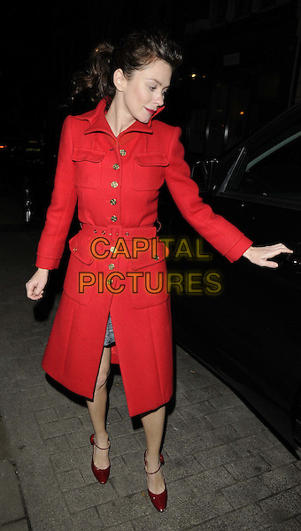 Anna Friel.departed after the evening performance of 'Uncle Vanya', Vaudeville Theatre, The Strand, London, England..January 7th, 2013.full length red jacket coat shoes hand arm profile .CAP/CAN.©Can Nguyen/Capital Pictures.