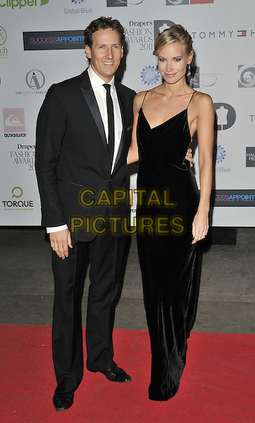 Brendan Cole & Zoe Hobbs.The Drapers Fashion Awards 2011, Grosvenor House hotel, Park Lane, London, England..November 16th, 2011.half length dress suit married husband wife black gold earrings .CAP/CAN.©Can Nguyen/Capital Pictures.