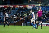 3rd October 2017, Ewood Park, Blackburn, England; Football League Trophy Group stage, Blackburn Rovers versus Bury; Blackburn's Sam Hart (5) is shown the yellow card for a bad foul against Bury's Phil Edwards (14)