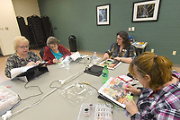 NWA Democrat-Gazette/FLIP PUTTHOFF <br /> Rhonda Pierson (from left) Sandra White, instructor Jackie Jackson and Quita Rusher work Wednesday March 13 2019 on their pictures during the diamond painting class.