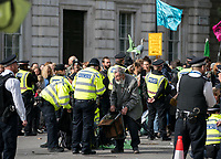 91-year-old Extinction Rebellion protestor is removed from the road at Whitehall.<br /> .<br /> Environmental activists from Extinction Rebellion protest in London on 09 October 2019 in London, England.<br /> .<br /> Protesters plan to blockade the London government district for a two week period, as part of 'International Rebellion' taking place in over 60 cities around the world, calling for decisive and immediate action from governments in the face of climate and ecological emergency. <br /> .<br /> Photo by Andy Rowland.