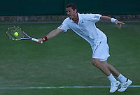 Marat Safin (RUS) (14) Jesse Levine (USA) in the first round of the gentlemen's singles. Levine beat Safin 6-2 3-6 7-6 6-4..Tennis - Wimbledon - Day 2 - Tues 23rd June 2009 - All England Lawn Tennis Club  - Wimbledon - London - United Kingdom..Frey Images, Barry House, 20-22 Worple Road, London, SW19 4DH.Tel - +44 20 8947 0100.Cell - +44 7843 383 012