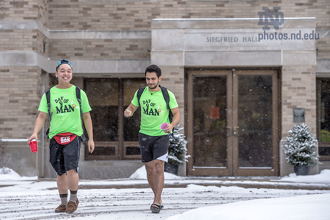 "Feb. 12, 2015; Siegfried Hall tradition ""Day of Man,"" a fundraiser for the South Bend Center for the Homeless. Siegfried residents wear shorts and t-shirts in cold weather to show solidarity with the homeless.  The red cups are for donations. (Photo by Matt Cashore/University of Notre Dame)"