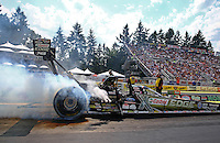 Aug. 2, 2014; Kent, WA, USA; NHRA top fuel driver Brittany Force during qualifying for the Northwest Nationals at Pacific Raceways. Mandatory Credit: Mark J. Rebilas-USA TODAY Sports