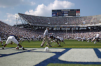 04 September 2004:  Joe Paterno encourages his players during pre-game stretching...Penn State defeated Akron 48-10 during their season opener 9-4-04 at Beaver Stadium in State College, PA....