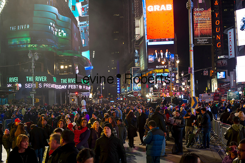 "Thousands upon thousands of tourists pack Times Square on Friday, December 30, 2011, the night before New Year's Eve. Mild weather predicted for New Year's Eve is expected to bring well over a million people to pack the ""Crossroads of the World"" celebrating the incoming 2012. (© Frances M. Roberts)"