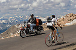 Motorcyclist and road biker on the Mount Evans Road, Idaho Springs, Colorado. Private photo tours to Mt Evans. .  John offers private photo tours in Denver, Boulder and throughout Colorado. Year-round.