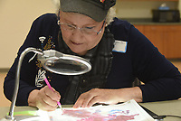 NWA Democrat-Gazette/FLIP PUTTHOFF <br /> ONE BEAD AT A TIME<br /> Victoria Ryan tries her hand Wednesday March 13 2019 at diamond painting during a class at the Rogers Adult Wellness Cneter. The art of diamond painting involves placing tiny colored beads on a pre-made pattern to create a picture. It's similar to embroidery, cross stitch and paint by numbers, said Jackie Jackson, teacher. One picture contains hundreds of colored beads. Wednesday was Ryan's first time to try the art form.