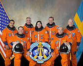 """Houston, TX - January 30, 2009 -- Attired in training versions of their shuttle launch and entry suits, these seven astronauts take a break from training to pose for the STS-128 crew portrait. Seated are NASA astronauts Rick Sturckow (right), commander; and Kevin Ford, pilot. From the left (standing) are astronauts Jose Hernandez, John """"Danny"""" Olivas, Nicole Stott, European Space Agency's Christer Fuglesang and Patrick Forrester, all mission specialists. Stott is scheduled to join Expedition 20 as flight engineer after launching to the International Space Station on STS-128.   It is scheduled for launch on August 25, 2009.  .Credit: NASA via CNP"""