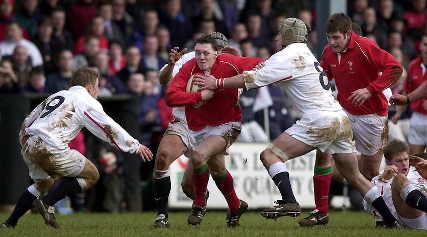 Photo. Richard Lane. .Wales U21 v England U21 at Sardis Road, Pontypridd, Wales. 2/2/2001.Shaun James attacks.