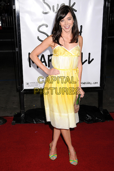 "ALYSON HANNIGAN .""Forgetting Sarah Marshall"" Los Angeles Premiere at Grauman's Chinese Theatre, Hollywood, California, USA..April 10th, 2008.full length yellow white dress hand on hip clutch bag purse .CAP/ADM/BP.©Byron Purvis/AdMedia/Capital Pictures."