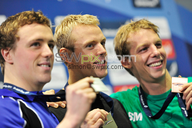 PICTURE BY SIMON WILKINSON/SWPIX.COM...Swimming - British Gas Swimming Championships 2011, Day 3 - Manchester Aquatics Centre, Manchester, England - 07/03/11...Mens 200m Freestyle Final - (L-R) Silver - Robbie Renwick, Gold - Ross Davenport, Bronze - David Carry.